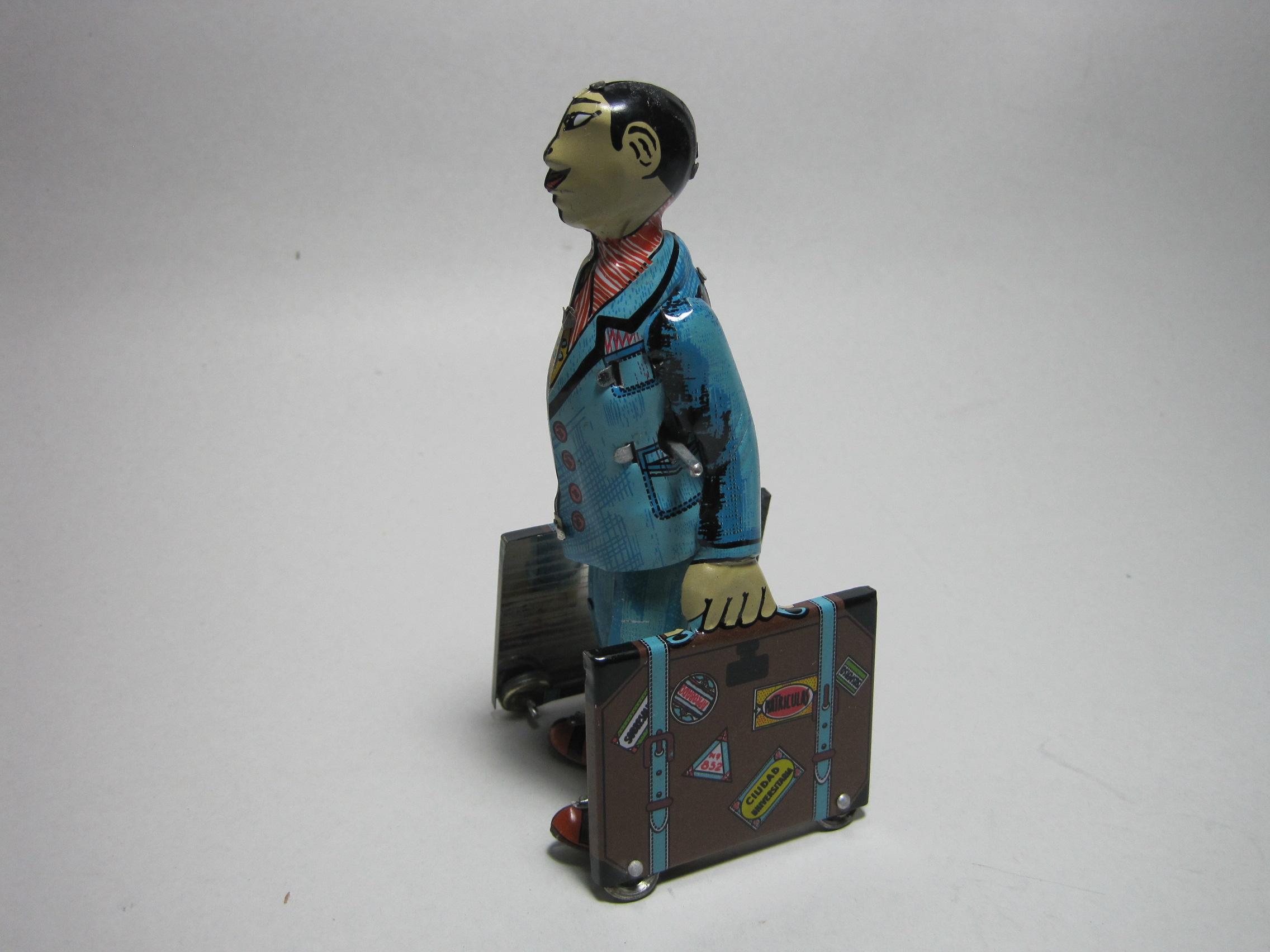 ของเล่นสังกะสี นักเดินทางถือกระเป๋า